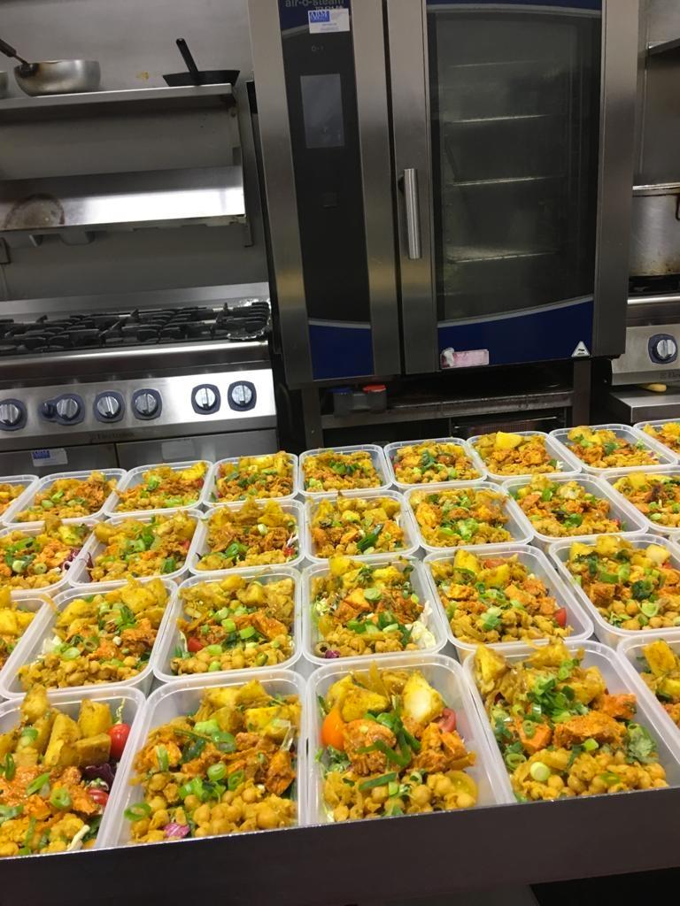 Boxes full of beautifully prepared Bangladeshi food