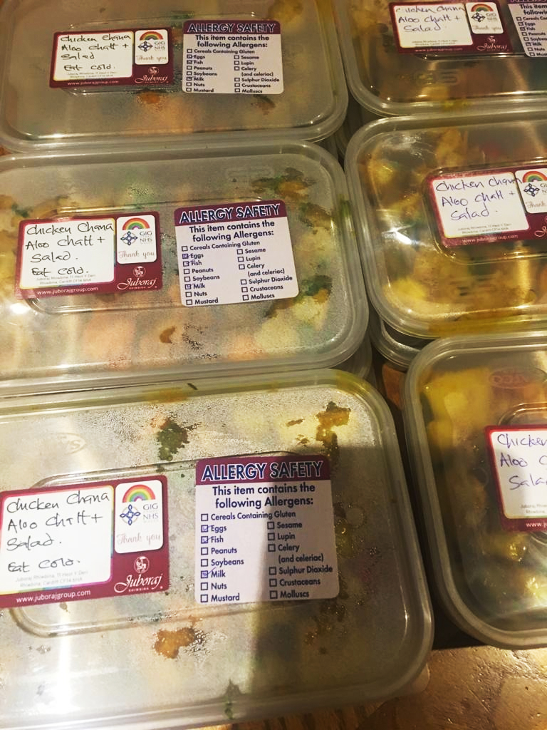 Boxes of food from the Juboraj in Rhiwbina packed up and labelled with thanks for the NHS