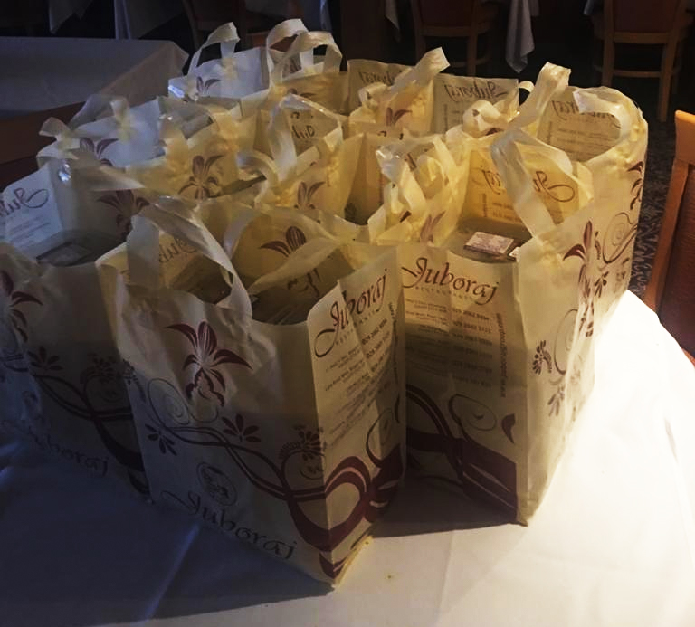 All the boxes of takeaway food for the NHS frontline packed into Juboraj takeaway bags